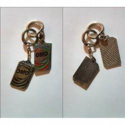 porte-clés Omo lessive, lot 2 paquets couleur et noir (pc)